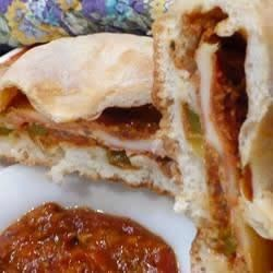 Philly-Style Stuffed Stromboli Recipe - This recipe, adapted to use the traditional flavors of Classico® Pasta Sauce, was originally submitted by Allrecipes home cook HEATHERB99.