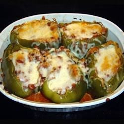 Easy Stuffed Green Peppers  Recipe - This recipe, adapted to use the traditional flavors of Classico® Pasta Sauce, was originally submitted by Allrecipes home cook GIDDYMOMMY.