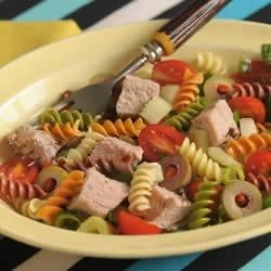 Wacky Mac(R), Pork and Tomato Salad with Chile Vinaigrette Dressing Recipe - Pork, tomatoes and olives mingle with Wacky Mac and Chile Vinaigrette for a truly unique salad, perfect for any summer BBQ.