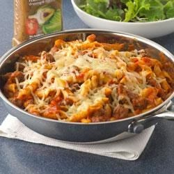 Penne Pasta Skillet Recipe - All you need to do to make a hearty, family-pleasing skillet supper is brown some ground beef, mix with pasta sauce and uncooked penne pasta, and top with mozzarella cheese. It's all made in one skillet.