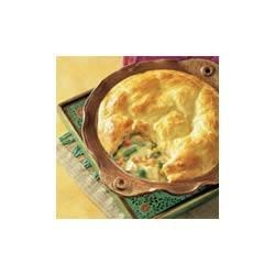 Biscuit-Topped Chicken Pot Pie Recipe - Mix creamy potato soup, chicken and vegetables into a savory filling for this biscuit-topped family favorite.