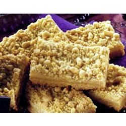 Apple Streusel Squares Recipe - This apple cake with a crumbly nut topping is excellent served warm with ice cream or whipped cream.