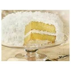 Classic ANGEL FLAKE Coconut Cake Recipe - Top this rich and indulgent coconut cake with a delicate swirl of grated lemon peel to add a little color.