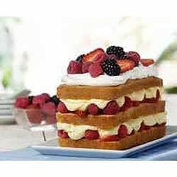 Berry Bliss Cake Recipe - Fresh berries and a creamy pudding mixture are layered between slices of pound cake for an easy summer dessert.