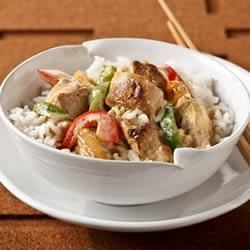 Thai Curry Chicken and Rice Recipe - Chunks of chicken breast and sliced onions are sauteed in flavorful Thai green curry paste, then cooked in a creamy sauce made with cream cheese and sliced red and green bell peppers. Serve over hot cooked rice.
