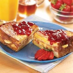 Peanut Butter, Berry & Banana Stuffed French Toast Recipe - Stuffed with banana slices and a strawberry syrup, cream cheese, and peanut butter mixture, this French toast is an indulgent breakfast treat.