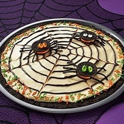 OREO Spider Web Cookie Pizza Recipe - Calling ghouls and goblins of all ages! This 'spooktacular' dessert features an OREO Cookie crust topped with a creamy combination of chocolate pudding and whipped topping. A chocolate spider web and a few cookie spiders add the perfect finishing touch.