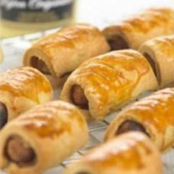 Sausage Rolls with Maille(R) Dijon Originale Mustard Recipe - Wrap pastry dough with a touch of Dijon mustard around cocktail sausages and ham and bake up tasty appetizers for your next party.
