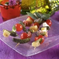 Ham and Cheese Skewers with Crunchy Maille(R) Cornichons Recipe - For a simple and tasty appetizer, simply place cornichons, cherry tomatoes, ham, and cubes of Swiss cheese on wooden skewers--and serve!