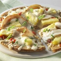 Monterey Jack Pita Pizza Recipe - With whole wheat pita bread topped with chicken strips and fresh pineapple, a tropical twist makes this an exciting take on an old favorite: pizza! Made with reduced-fat Monterey Jack or Mozzarella cheeses, this recipe contains a small amount of lactose, but is a friendly option for those who are lactose intolerant.