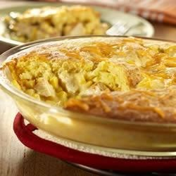 Cornbread Chicken Pot Pie Recipe - You'll think back to simpler times when you serve this rich, cornbread-topped pot pie right in your own home.