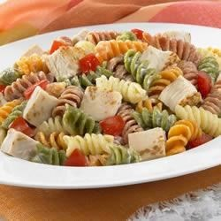 Chicken Ranch Pasta Salad Recipe - Toss chicken and pasta with colorful vegetables and creamy ranch dressing for this easy and satisfying main dish pasta salad.