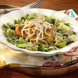 Roasted Chicken Thighs over Braised Escarole with Pine Nuts and Mozzarella Recipe - Delicious, healthy and simple: baked chicken and braised escarole comes complete with Sargento Shredded Reduced Sodium Mozzarella.
