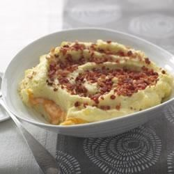 Cheddar-Mashed Potato Casserole Recipe - Enjoy this low-tending potato classic with a surprise layer of cheese in the centre of the casserole.