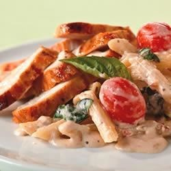 Creamy Tomato-Basil Pasta with Chicken Recipe - A few fresh ingredients transform chicken and pasta into this simple and creamy flavor-filled dish.