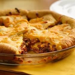 Cheeseburger Crescent Bake Recipe - Ground beef is mixed with ketchup, relish, and shredded cheese, topped with crescent triangles, and baked until golden brown and bubbly for a tasty, family-pleasing dinner bake.