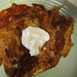 Three Cheese Enchiladas with Five Pepper Enchilada Sauce Recipe - Three kinds of cheese in these enchiladas complements the heat in the spicy tomato sauce.
