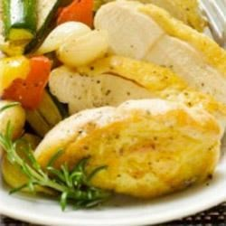 Marinated Chicken with Maille(R) Dijon Originale Mustard Recipe - Marinated chicken strips are baked and served alongside seasonal vegetables such as green beans, baby carrots, or asparagus, for a simple and satisfying supper.