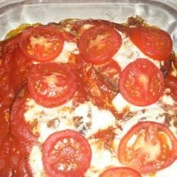 Eggplant, Tomato, and Cheese Bake Recipe - This recipe, adapted to use the traditional flavors of Classico® Pasta Sauce, was originally submitted by Allrecipes home cook MBC.