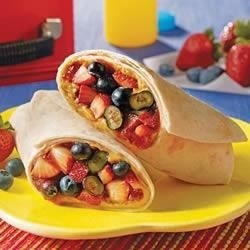 Very Berry Delicious Burrito Recipe - Fresh blueberries and strawberries with peanut butter and strawberry jam make a burrito bursting with fruity goodness in these quick lunch or snack treats.
