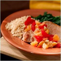 Pork Chops with Mandarin Orange Salsa Recipe - A savory fruit-based salsa anchors this colorful, fruit- and vegetable-rich meal.  Tender pork chops slowly marinated and baked to perfection are highlighted by the lime and orange undertones of this flavorful experience.