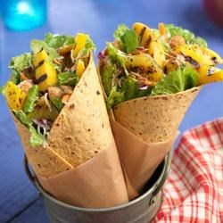 Beach Goers' Wraps Recipe - Grill up some sweet ripe pineapple, peach, and mango slices, toss with raspberry vinegar and fresh salad mix for a perfect, summer wrap.