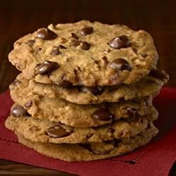 Ghirardelli Crispy Crunchy Chocolate Chip Cookies Recipe - For those who love their cookies crispy, these large, thin cookies--loaded with chocolate and pecans--bake up dark golden brown for extra crunchy goodness.