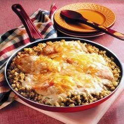 Chicken and Stuffing Skillet Recipe - The down-home flavors of tender chicken and Pepperidge Farm(R) Stuffing are paired with a perfect sauce made with Campbell's(R) Condensed Cream of Mushroom Soup and Cheddar cheese.