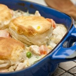Easy Chicken and Biscuits Recipe - A creamy chicken and vegetable casserole is topped with flaky, golden biscuits.