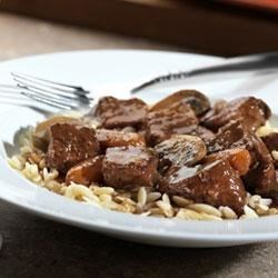 Beef Bourguignonne Recipe - Swanson(R) Beef Broth and a little red wine smooth out the savory herb and earthy flavors in this skillet simmered beef and mushroom main dish, served over orzo.