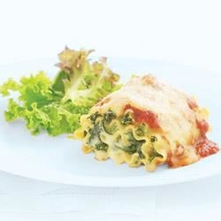 Spinach Lasagna Rolls Recipe - Spinach, Parmesan, mozzarella, and cream cheese make a flavorful filling to roll up in cooked lasagna noodles. The rolls are topped with pasta sauce and additional Parmesan cheese, then baked until hot and bubbling.