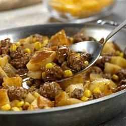 South-of-the-Border Beef Stew Recipe - Corn and potatoes beef up this Southwestern-inspired chili with ground beef, onion, tomato and chili powder.