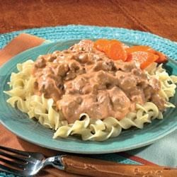 Campbell's Kitchen Mexican Stroganoff Recipe - Hot cooked egg noodles are topped with a savory mixture of ground beef, onion, taco seasoning mix, Campbell's(R) Condensed Cream of Mushroom with Roasted Garlic Soup, sour cream and Pace(R) Picante Sauce.