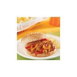 Chipotle Chicken Sandwiches Recipe - The smoky flavor of chipotle flavors these delicious chicken and peppers sandwiches highlighted by a mouthwatering barbecue sauce.