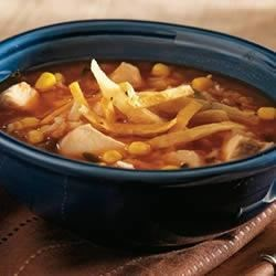 Hearty Chicken Tortilla Soup Recipe and Video - This hearty, satisfying soup simmered in golden Swanson(R) Chicken Broth features chunks of chicken, corn, rice and salsa, and is garnished with cilantro and lime.