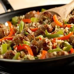 Savory Sausage and Rice Skillet Recipe - This one-dish skillet supper features Italian sausage sauteed with onion, green and red peppers, celery and garlic, then simmered in Swanson(R) Chicken Stock with a brown and wild rice medley.