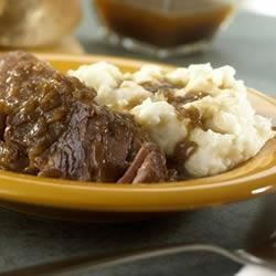 Melt-In-Your-Mouth Short Ribs Recipe - Slow-cooked in a mouthwatering sauce seasoned with thyme and garlic, these tender short ribs are full of flavor.