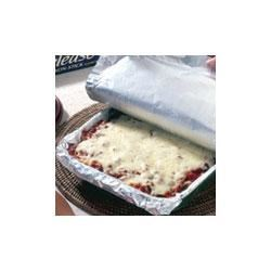 Baked Spaghetti Recipe - Spaghetti is layered like lasagna with ricotta cheese, Italian tomato sauce, and mozzarella cheese for this fun and tasty baked pasta casserole.