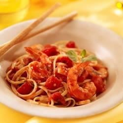 Shrimp Fra Diavolo Recipe - Succulent shrimp simmered in a spicy tomato sauce served over pasta to capture all the sauce.