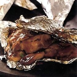 Foil-Baked Chicken Recipe - Individual foil packets contain chunks of chicken in a savory soy and hoisin sauce with cilantro and fresh ginger.