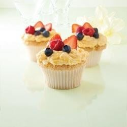 Angel Lush Cupcakes Recipe - A tropical pineapple frosting tops these angel food cupcakes.