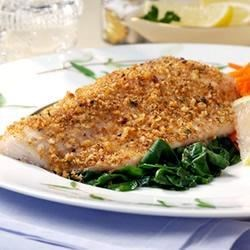 White Fish with Crisp Garlic Crust Over Sauteed Spinach