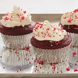 Classic Red Velvet Cupcakes Recipe - Originally from Down South, and once the signature dessert at the Waldorf-Astoria in the 1920s, the Red Velvet Cake has become an American favorite. It's hip, fun, and easy to make. Red Velvet -- in cake or cupcake form -- is a hit at every party.