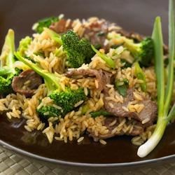 Beef and Broccoli Stir Fry with Whole Grain Brown Rice Recipe - It's not beef and broccoli without rice. Begin with Uncle Ben's(R) Whole Grain Brown Rice, then add minced garlic, soy sauce, and stir-fry things up for an unforgettable dish.