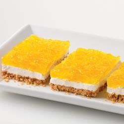 Creamy Marshmallow and Pineapple Squares Recipe - A sweet and creamy layer on a graham cracker crust is topped with lemon JELL-O and pineapple for this crowd-pleasing dessert.