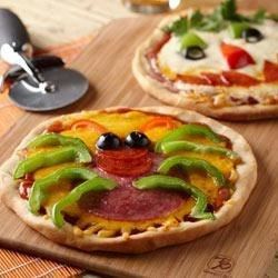 Creepy Mini Pizzas Recipe - Set out your favorite pizza toppings and let everybody create their own spooky or fun masterpiece!