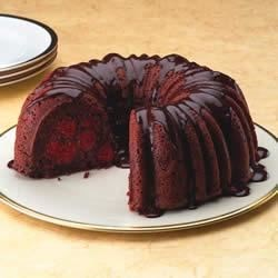 Chocolate Cherry Cake with Rum Ganache Recipe - Rich chocolate cake is layered with cherry pie filling and spread with a creamy ganache.