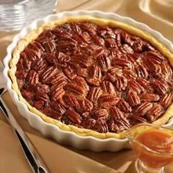 Caramel-Pecan Pie Recipe - This gooey pecan pie is a dream for anyone searching for a delicious, yet extremely easy dessert to put together during the holidays.