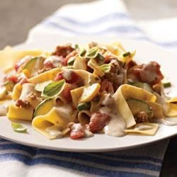 Sausage-Vegetable Ragout Pappardelle Recipe - A creamy cheese and herb sauce with chunks of turkey sausage, zucchini and yellow squash, and tomatoes is served over hot, cooked pappardelle pasta--and it's on the table in less than half an hour!