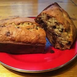 Melted Banana Bread Recipe - Two or three ripe bananas and some chocolate chips are a delicious combination in this banana bread. From the kitchen of Heather Hill.